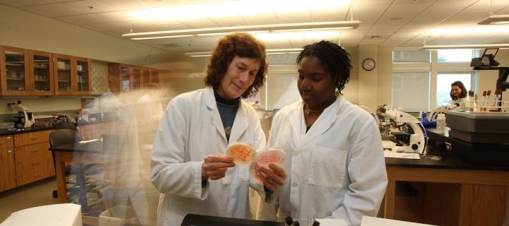 student and professor in laboratory