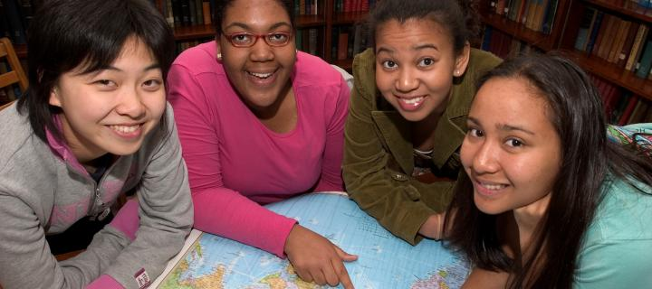 Students around a map