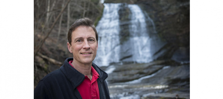 andy zepp portrait in front of waterfall