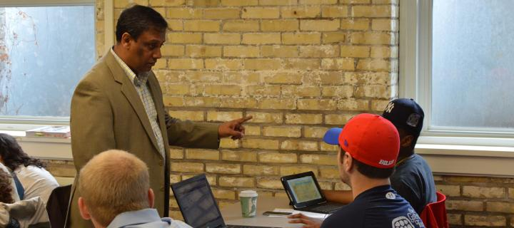 Professor Dhameeth speaking with students