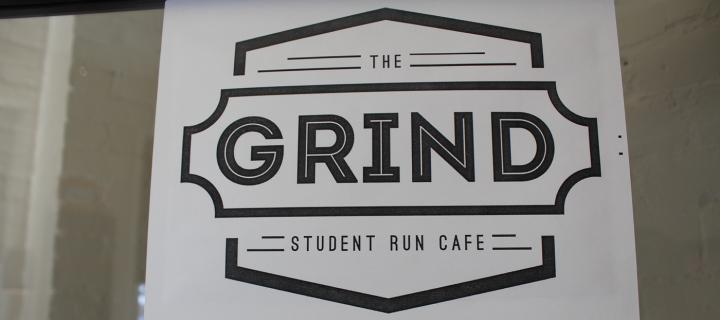 sign from the door of The Grind student-run cafe