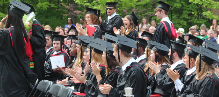 students in regalia at commencement