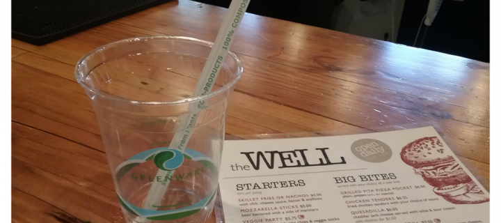 compostable cup and straw with menu for the well