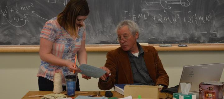 professor scott heinekamp helping student