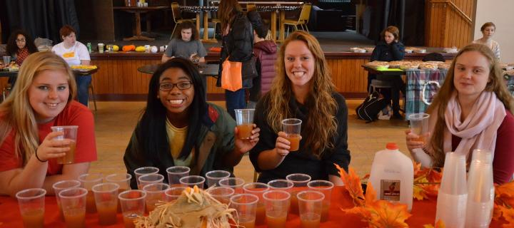 students with apple cider at autumnfest