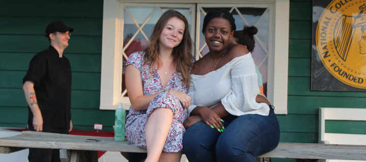 two students at the athletic association house for opening picnic and barbecue