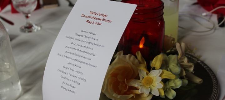 photos of honors awards dinner program and floral table centerpiece