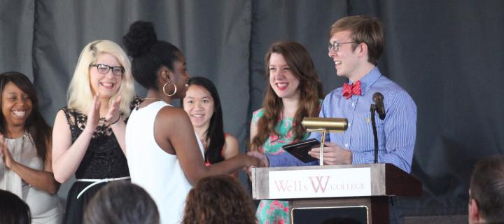 student receiving award from collegiate cabinet members