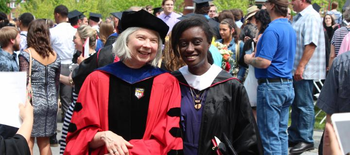 faculty and student at Commencement