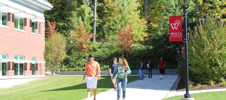 photo of students on sidewalk between buildings