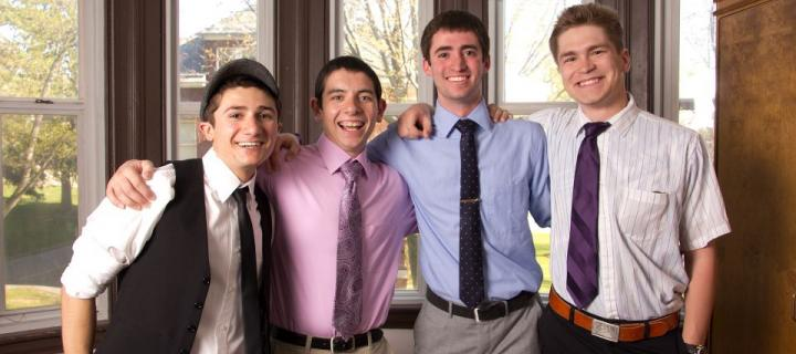 Smiling male members of the class of 2015