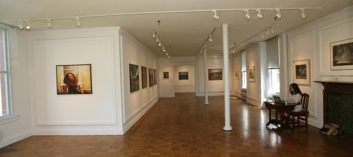 string room gallery with student at desk