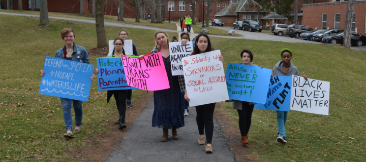 students holding signs with political messages