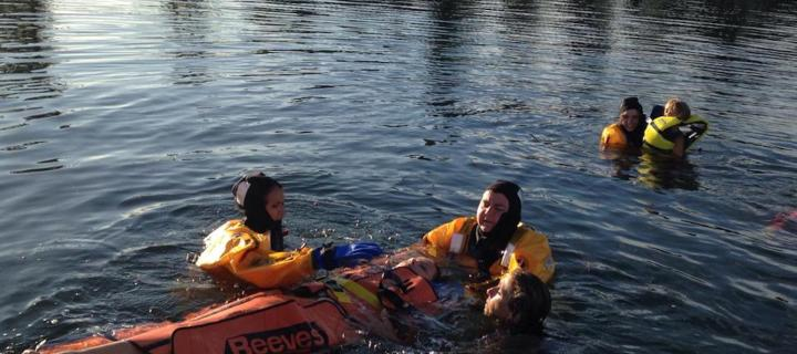 students in rural health program performing a water rescue