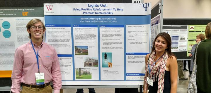 Students with their poster at the conference
