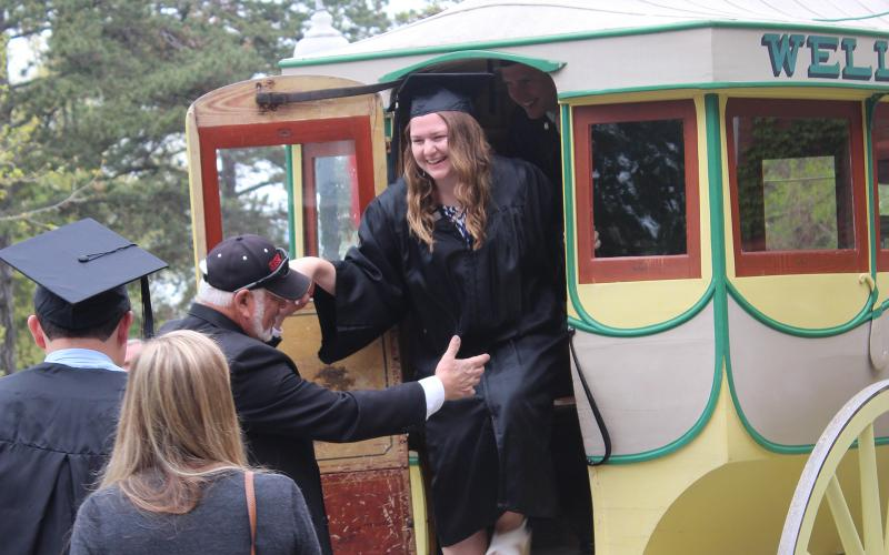graduate stepping off wells stagecoach