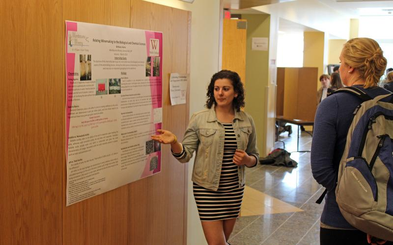 student in stratton hall poster session