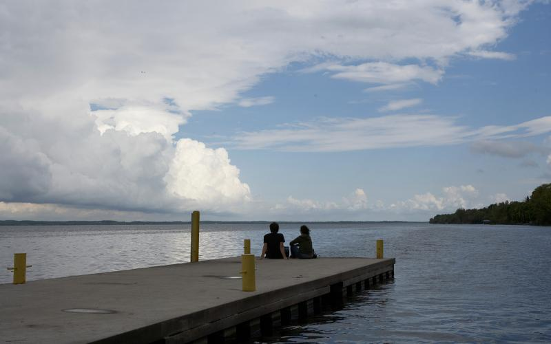 students sitting on the dock