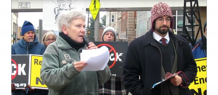 colleen boland speaking at a protest
