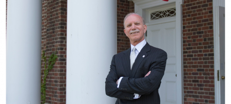 portrait of president gibralter in front of macmillan hall
