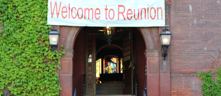 macmillan hall entryway with welcome to runion sign, ivy and stained glass