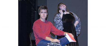 student actors holding book and telephone, looking distressed