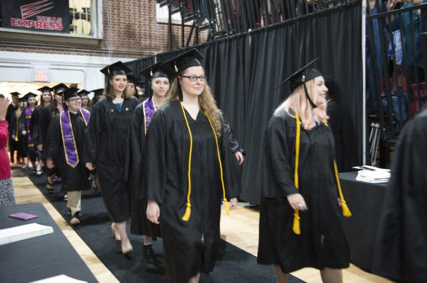 Students walk during the processional