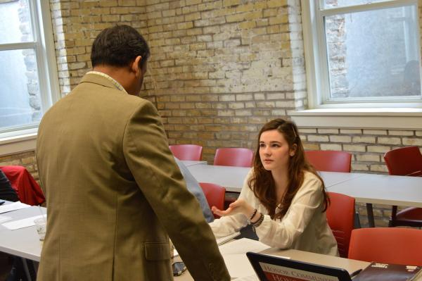Business Student speaking with Professor Dhameeth