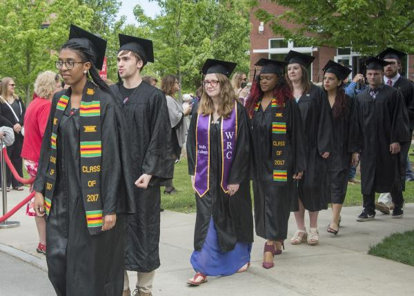 students in robes marching