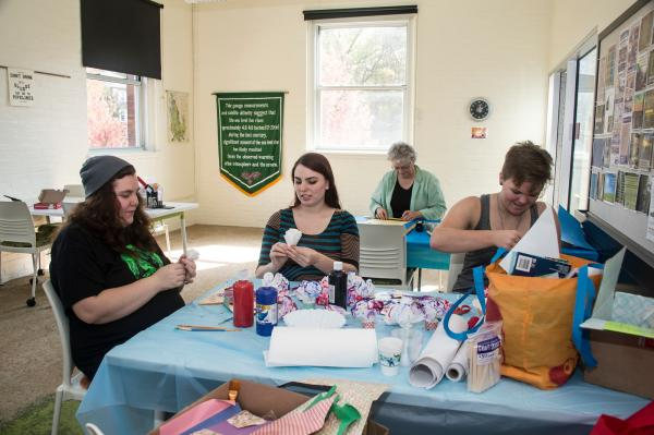 Students and alumnae working on a project at the Book Arts and Sustainability Center
