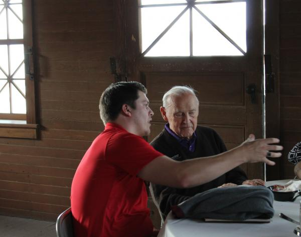 Two community members conversing in the Boathouse