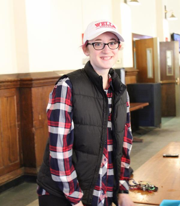 photo of student in the dining hall with wells college hat