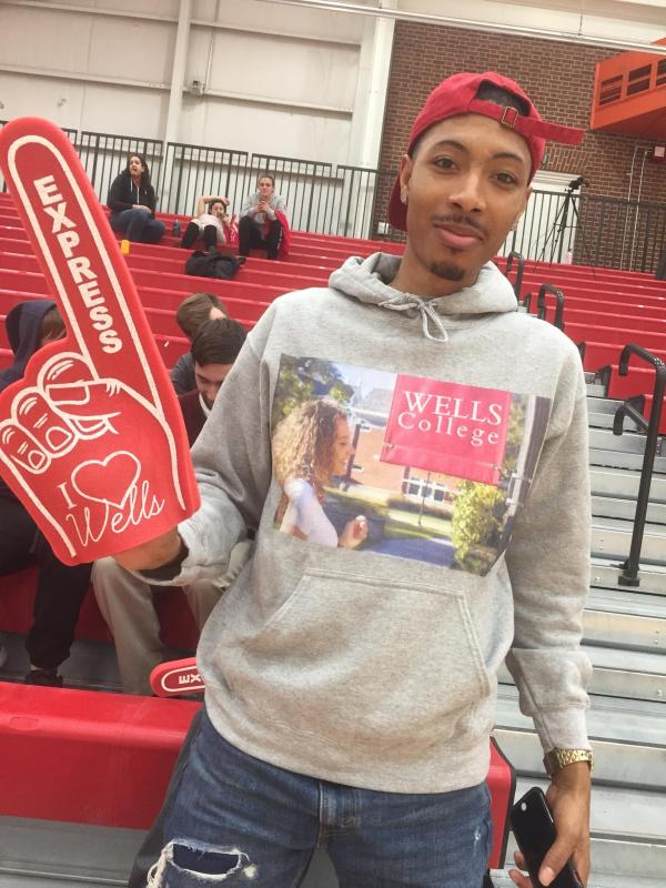 photo of student with wells sweatshirt and foam finger