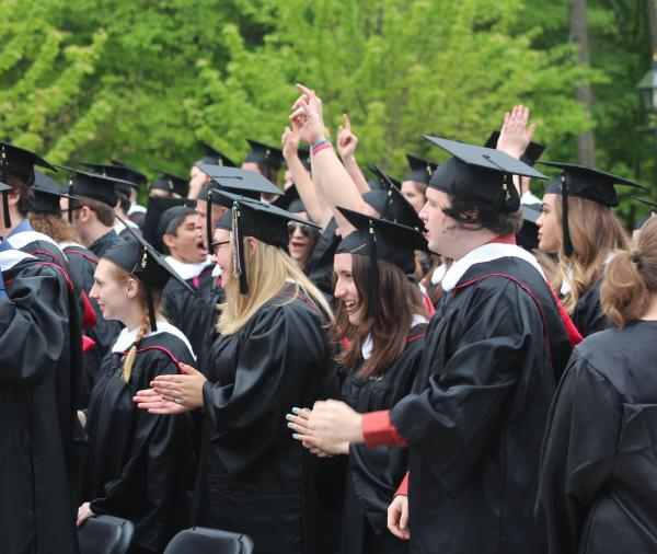 image of graduates cheering at commencement