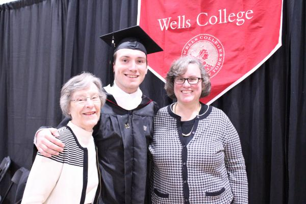 A graduate with family members