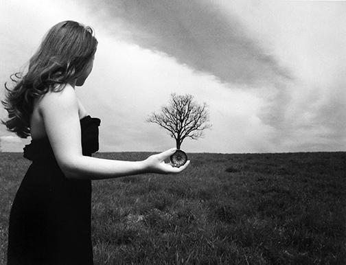photo of woman with tree by Julia Forrest