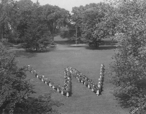 vintage image of people standing in the shape of a W