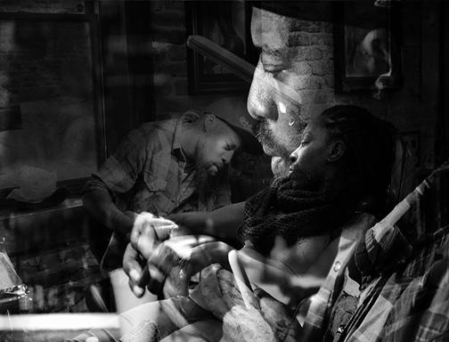 photo of tattoo artist by Regina Agoruah