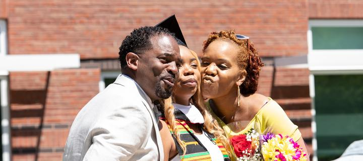 A graduating student and her family pose for a picture