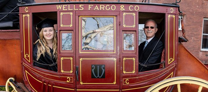 President Gibralter and a graduating senior ride the stagecoach