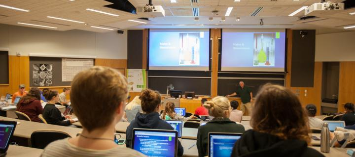 Students taking notes during lecture in Stratton 209