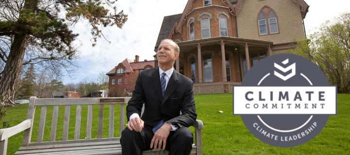 President Gibralter on a bench in front of Pettibone House