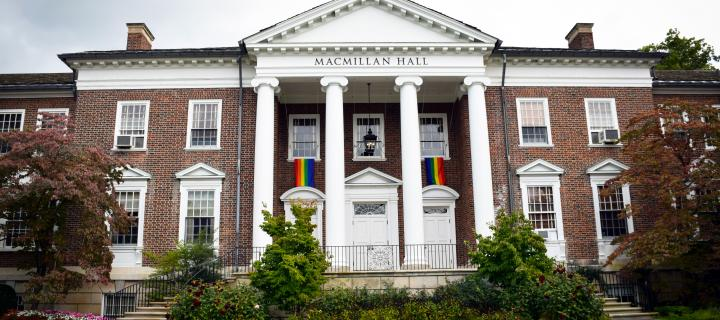 Macmillan hall with rainbow flags hanging from windows