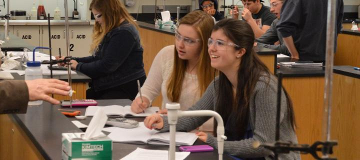students taking notes during lab