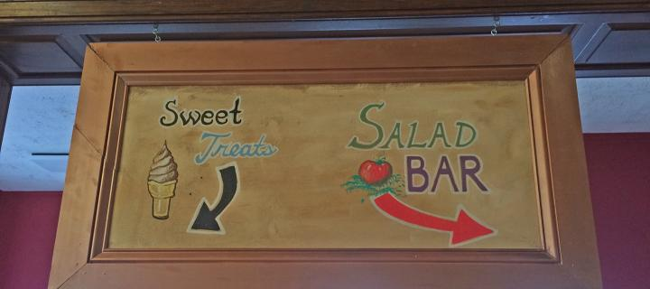 sweet treats and salad bar sign in the dining hall