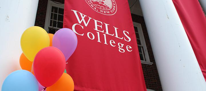 Wells College banner flag with festive balloons