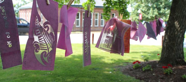 Book Arts items hanging on the line outside