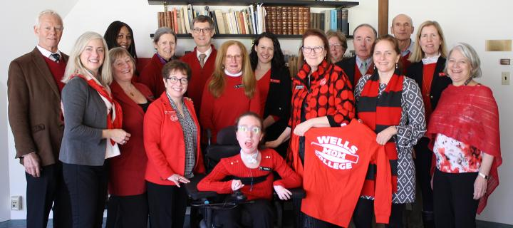 Group photo of trustees wearing red to celebrate I Heart Wells Week