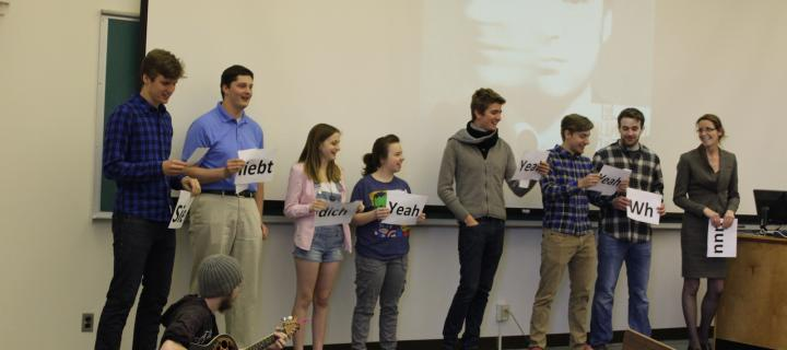 students on stage for german language presentation
