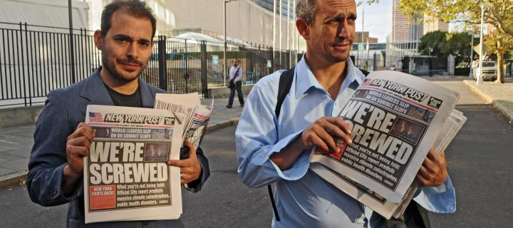 the yes men holding fake new york post